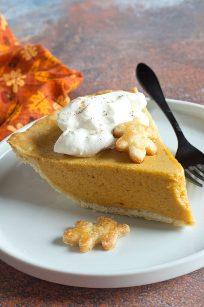 A slice of pumpkin chiffon pie with whipped cream.